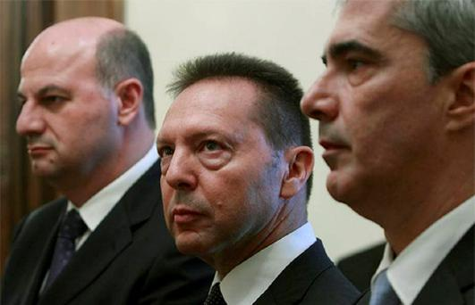 Newly appointed Greek Finance Minister Yannis Stournaras (C), Government spokesman Symeon Kedikoglou (R) and Deputy Foreign Minister Costas Tsiaras attend a swearing-in at the presidential palace in Athens. Photo: Reuters