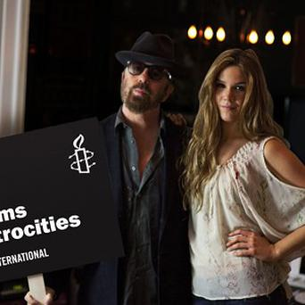 Dave Stewart and Joss Stone are supporting Amnesty International's call for a strong arms trade treaty