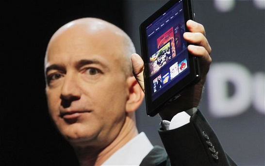 Amazon's chief executive Jeff Bezos with the company's existing tablet, the Kindle Fire Photo: Getty