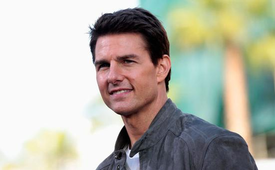 Cast member Tom Cruise poses at the premiere of