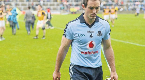 Dejected Tomas Brady, leaves the pitch after Dublin's defeat to Kilkenny two weeks ago.