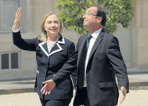 Hillary Clinton and Francois Hollande in Paris yesterday