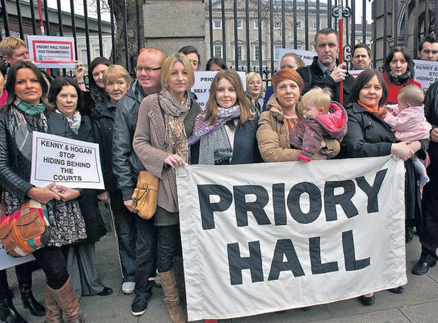 Empathy: Stacey Dooley (centre with long hair and scarf) with evacuated Priory Hall demonstrators protesting outside the Dail