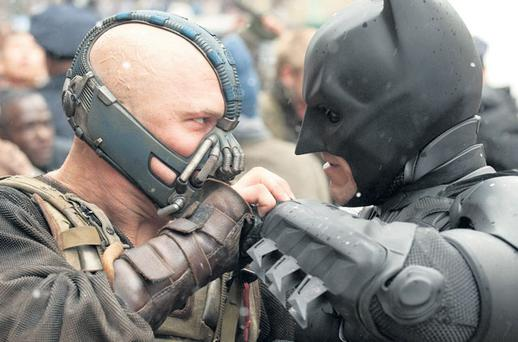 Batting confidently: Christian Bale's Batman grapples with Tom Hardy's Bane in a scene from The Dark Knight Rises