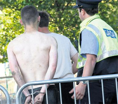 A reveller is arrested by gardai