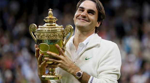 Roger Federer holds the winners trophy after defeating Andy Murray in the Wimbledon men's final. Photo: Reuters