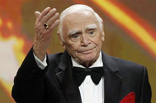 Lifetime achievement honoree Ernest Borgnine waves after receiving his award at the 17th annual Screen Actors Guild Awards in Los Angeles in 2011. Photo: Reuters