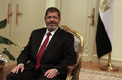 Egyptian President Mohammed Morsi looks on during a photo opportunity during his meeting with Turkish Ambassador to Egypt. Photo: AP