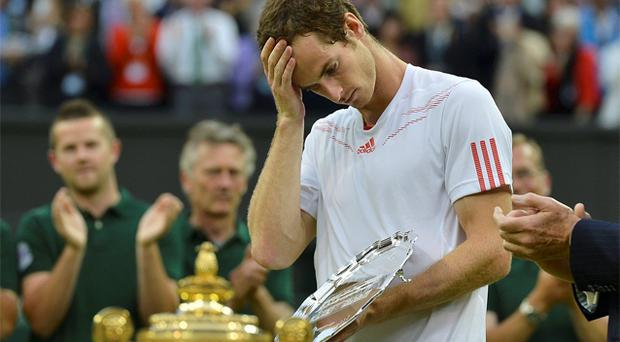 Andy Murray holds his runners-up trophy