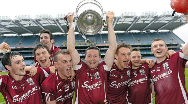Galway players (l-r): Johnny Coen, Conor Cooney, Jonathan Glynn, Damien Hayes, Niall Burke, Andy Smith and Joe Canning celebrate with the Bob O'Keeffe Cup
