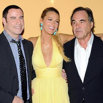 Director Oliver Stone (right) with John Travolta and Blake Lively at the New York premiere of Savages (AP)
