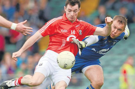 Clare 'keeper Joe Hayes closes down Cork's Donncha O'Connor