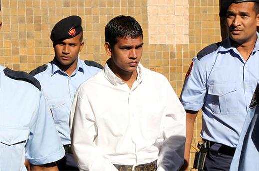 Avinash Treebhoowoon accompanied by officers arrives at the Supreme Court in Port Louis. Photo: PA