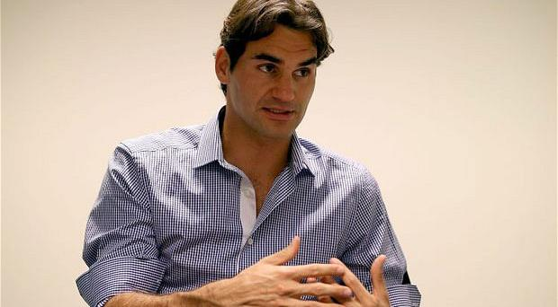 Morning after feeling: Roger Federer discusses his Wimbledon triumph witht he media on Monday Photo: Getty Images