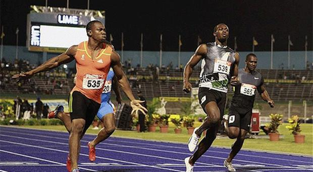 Yohan Blake, left, beats Usain Bolt in the 100 metres event at the Jamaica trials in Kingston in June. Photo: Reuters