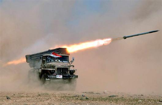 Syrian troops participate in a live fire exercise in an undisclosed location in Syria. Photo: AP