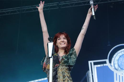 Florence Welch of Florence and the Machine performing on stage. Photo: Collins