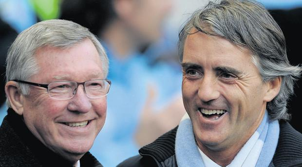 Roberto Mancini's new contract will see him second only to Jose Mourinho in the managerial pay stakes, with Alex Ferguson (left) being paid only just over half of what his Manchester rival gets
