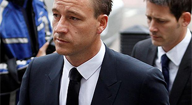 John Terry arriving at court for the second day of his trial