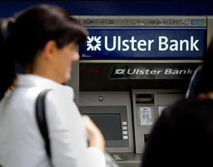 People queue to withdraw cash from an ATM at the Ulster Bank branch on Dublins O'Connell Street. Picture; GERRY MOONEY. 23/6/12