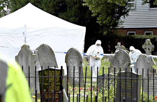 Police forensics at the scene outside a church in Writtle, Essex, after a man wanted for the murder of a police officer was found dead. Photo: PA