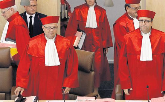 President of the German Constitutional Court Andreas Vosskuhle (right) arrives with other judges for the hearing on the European Stability Mechanism (ESM) and the fiscal pact in Karlsruhe yesterday.