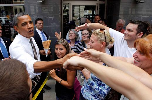 US President Barack Obama greets bystanders after buying ice cream at Deb's Ice Cream and Deli in Cedar Rapids, Iowa. Photo: Reuters