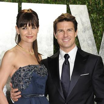 Tom Cruise and Katie Holmes have reached an agreement in their divorce case, according to her lawyer (AP)