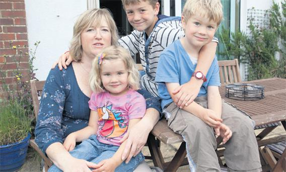 Fear overcome: Fran Benson and her children Sam (centre), Jack and Poppy