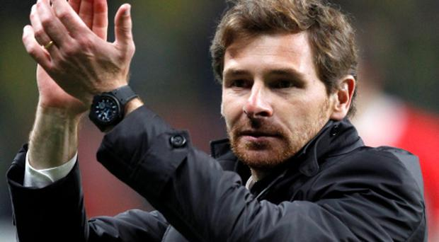 Head coach Andre Villas Boas applauds as he celebrates their victory over Spartak Moscow in their Europa League quarter-final second leg soccer match at Luzhniki stadium in Moscow in this April 14, 2011 file photo. Villas-Boas has signed a three-year contract as manager of Tottenham Hotspur, the Premier League club said on July 3, 2012. REUTERS/Grigory Dukor/Files (RUSSIA - Tags: SPORT SOCCER)