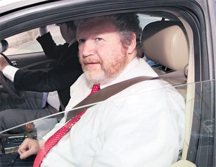 Health Minister James Reilly arriving at Government Buildings to give a statement to the Dail last night