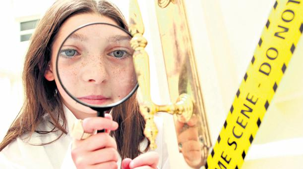 Ten-year-old Meabh O'Flaherty from Killester, Co Dublin, at the Cracking Crime with Science workshop at the Royal College of Surgeons in the capital yesterday. It was part of the Science in the City festival
