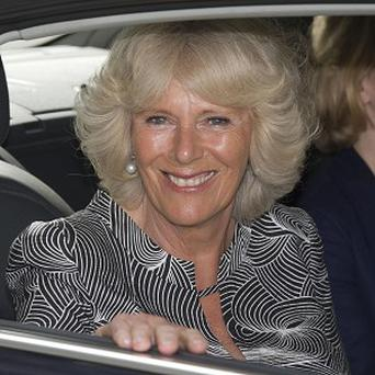 The Duchess of Cornwall had to deal with a young girl who was reluctant to hand over some flowers