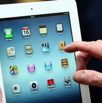 The use of electronic devices such as iPads in the House of Lords helps ministers access 'direct and accurate information', Lord Sewell said