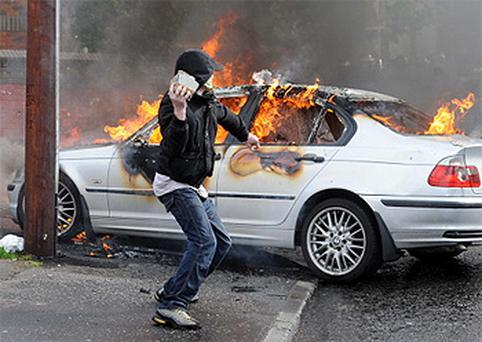 Rioters at Ardoyne in North Belfast after the 12th of July parades. Photo: Colm Lenaghan/ Pacemaker