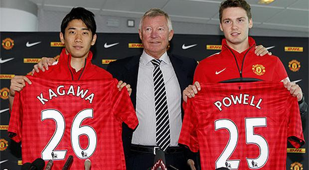 Manchester United manager Sir Alex Ferguson (centre) unveils new signings Shinji Kagawa (left) and Nick Powell