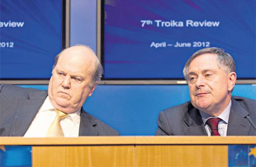 Finance Minister Michael Noonan and Public Expenditure and Reform Minister Brendan Howlin at a press briefing yesterday at Government buildings on the 7th troika review.