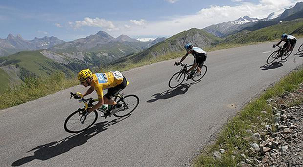 Yellow jersey holder Bradley Wiggins of England leads the chasing pack down the Croix de Fer pass during yesterday's 11th stage of the Tour de France