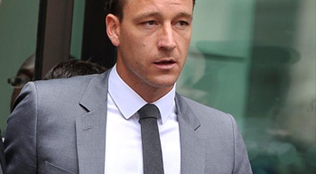 John Terry leaves court after a not guilty verdict was reached of his alleged racial abuse trial. Photo: PA