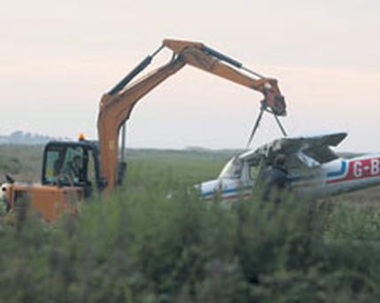 The light aircraft is removed from the crash site at Newcastle Airfield, Co Wicklow, yesterday. Photo: GARRY O'NEILL