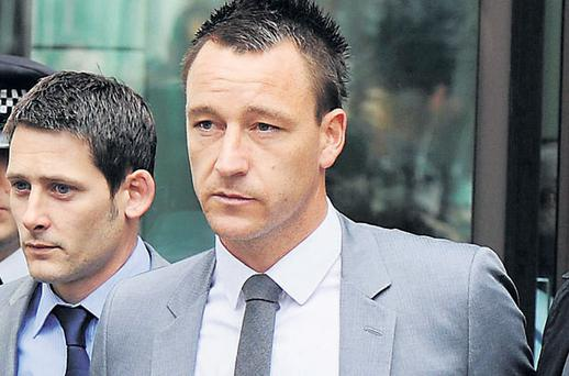 Chelsea footballer John Terry leaving Westminster Magistrates' Court yesterday after he was cleared of racially abusing Anton Ferdinand