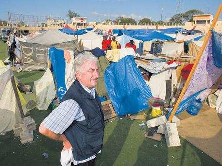 RESCUE MISSION: John O'Shea at a temporary camp for survivors of the earthquake in Port-au-Prince, Haiti, in 2010.