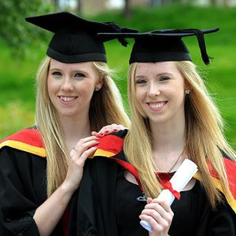 Mel Walker, left, and identical twin Hollie both achieved first class honours in law at Northumbria University