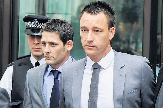 John Terry leaving Westminster Magistrates' Court after he was cleared of racially abusing Anton Ferdinand