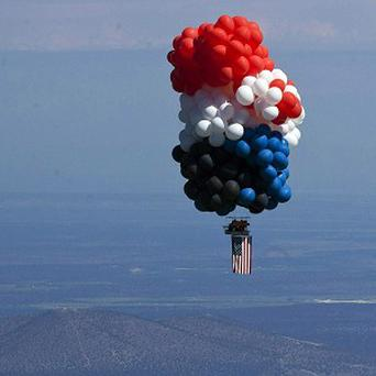Oregon gas station owner Kent Couch and Iraqi adventurer Fareed Lafta lift off (AP)
