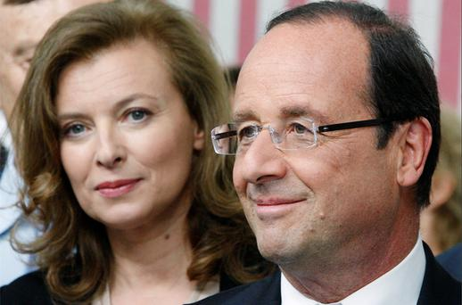 France's President Francois Hollande and his companion Valerie Trierweiler (L) visit the gallery Yvon Lambert during the Avignon festival