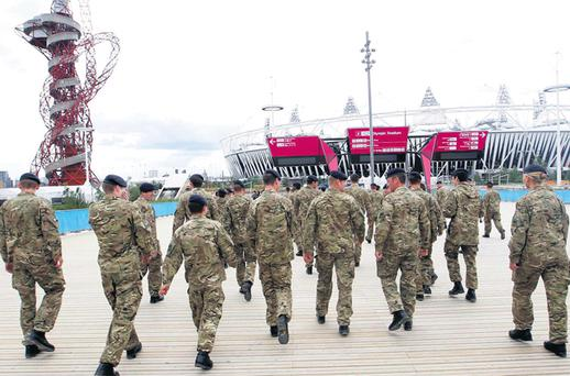 Members of the British army tour the Olympic stadium in Stratford, London, yesterday, ahead of the Games later this month