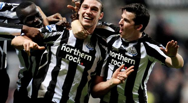 Andy Carroll celebrates scoring during his time at Newcastle