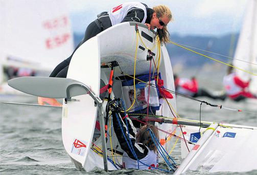 Ali Ten Hove and Meredith Megarry from Canada after their boat capsized during the Four Star Pizza ISAF Youth Sailing World Championship in Dun Laoghaire Harbour, Co Dublin.