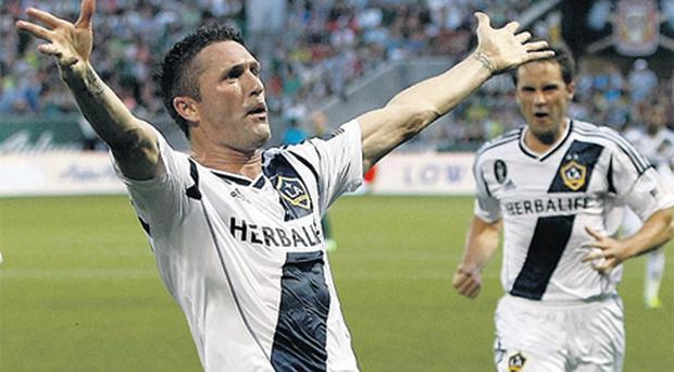 Robbie Keane celebrates scoring a goal for Galaxy in the first half against the Portland Timbers